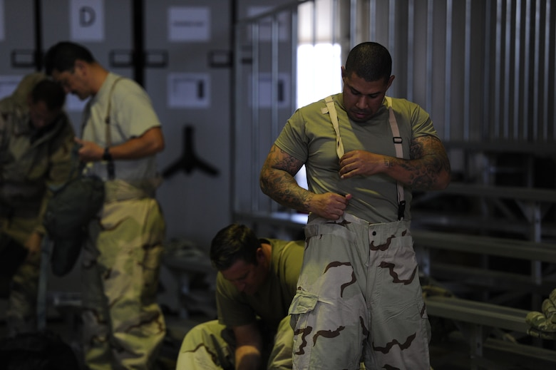 Staff Sgt. Gilbert Brooks, assigned to the 940th Logistics Readiness Squadron secures his chemical, biological, radiological and nuclear trousers June 13, 2020, at Beale Air Force Base, California.