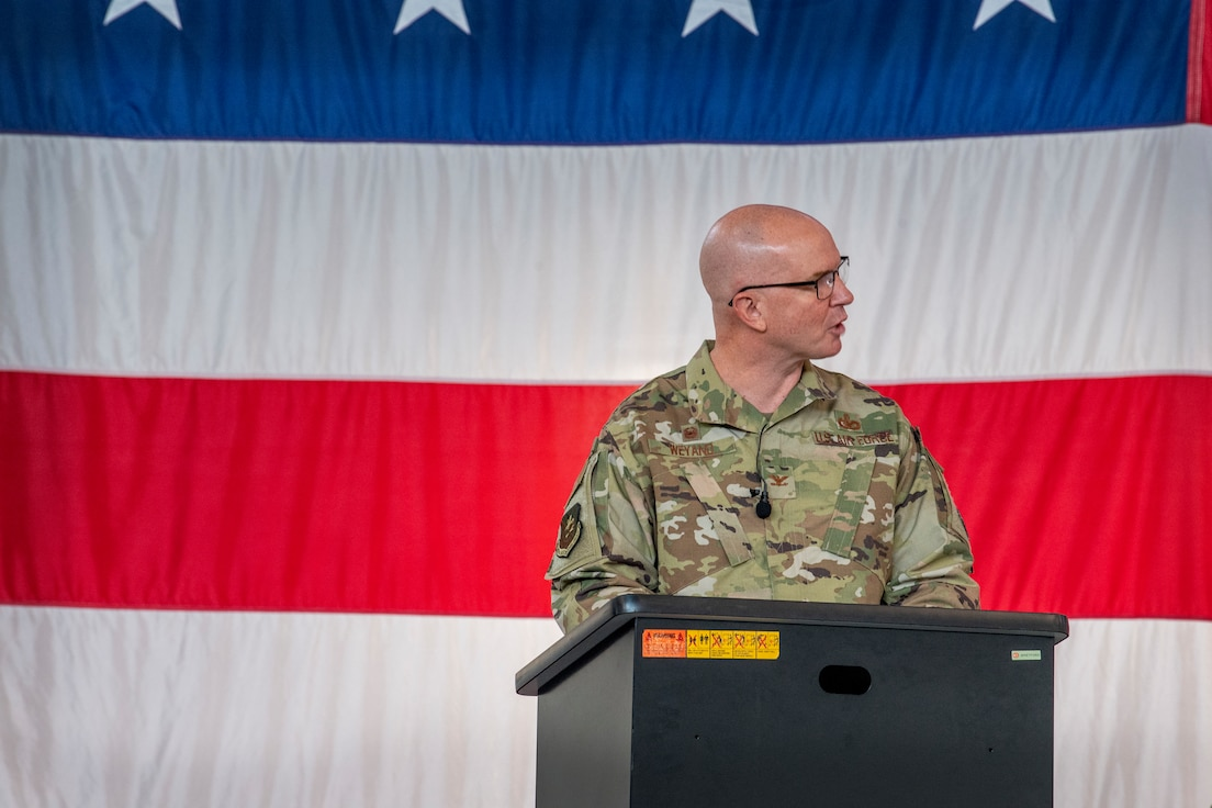 Col. Weyand speaks from a podium
