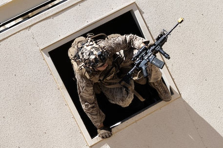 U.S. Marine Corps Pfc. Wyatt A. Miller with 3rd Battalion, 1st Marine Regiment, 1st Marine Division, jumps through a window during Integrated Training Exercise (ITX) 5-20 at Marine Corps Air Ground Combat Center (MCAGCC), Twentynine Palms, Calif., June 6, 2020. ITX is the most comprehensive training conducted at MCAGCC and focuses on the tactical application of combined-arms maneuver, offensive and defensive operations during combat. (U.S. Marine Corps photo by Lance Cpl. Shane T. Beaubien)