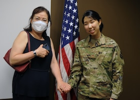 Staff Sgt. Dana Lee, 69th Aerial Port Squadron, air transportation technician, poses for a photo with her mother, Chanel Lee, after being sworn into active duty June 15, 2020, at Joint Base Andrews, Md. Lee is one of eight Airmen selected Air Force-wide for the Enlisted to Medical Degree Preparatory Program. (U.S. Air Force photo by Staff Sgt. Cierra Presentado)