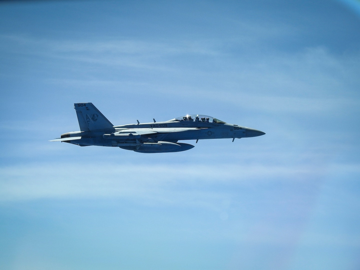 """A United States Navy E/A-18G Growler from Electronic Attack Squadron 209, the """"Star Warriors,"""" flies with a B-52H Stratofortress deployed from Barksdale Air Force Base, La., over the Sea of Japan while conducting a Bomber Task Force mission June 16, 2020. U.S. Strategic Command operations and engagements with U.S. allies and partners demonstrate and strengthen a shared commitment to global security and stability. (Courtesy photo)"""
