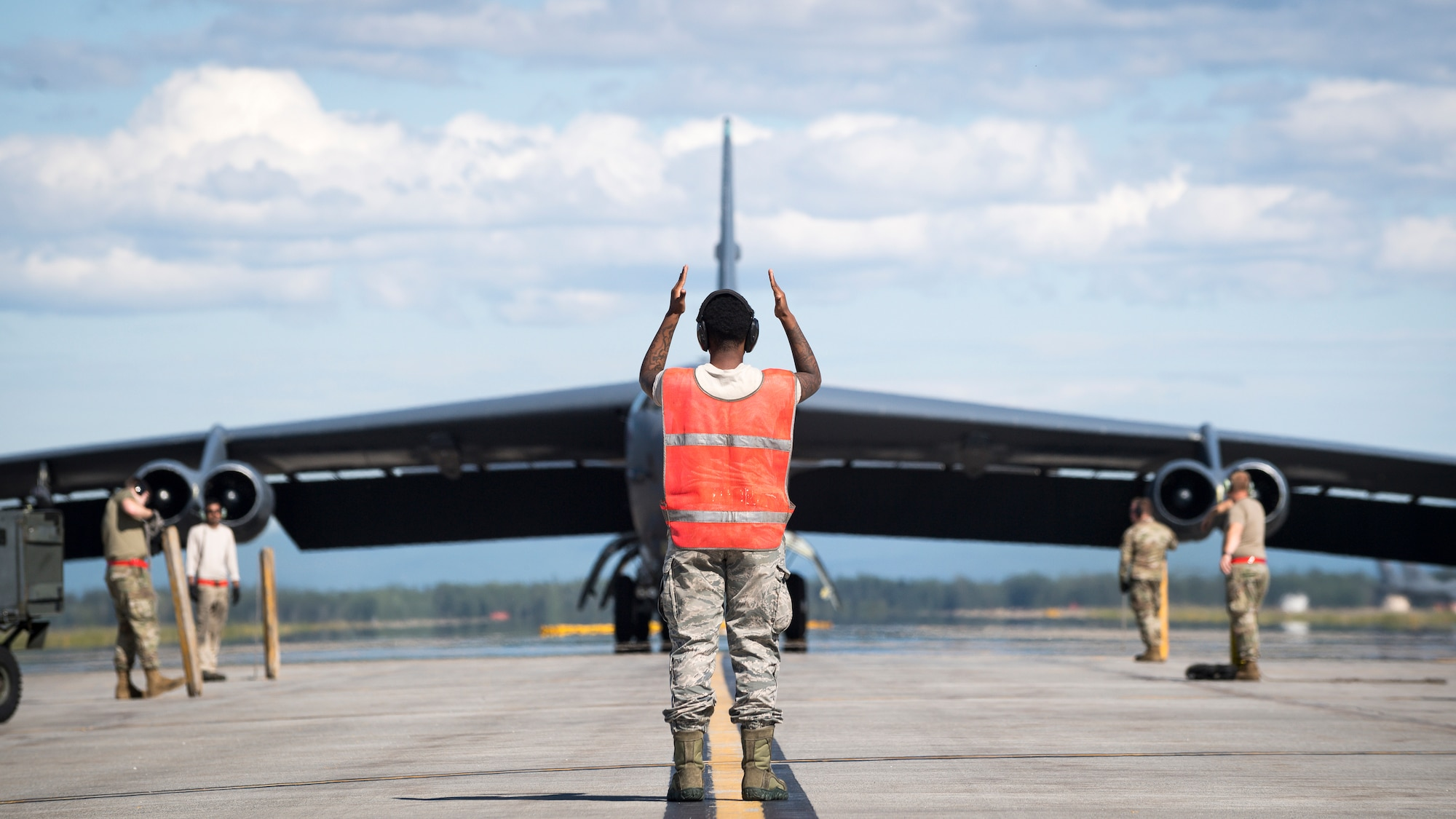 Senior Airman Jar'quayla Doss, 96th Aircraft Maintenance Unit electronic countermeasures journeyman, marshalls a B-52H Stratofortress deployed from Barksdale Air Force Base, La., at Eielson Air Force Base, Alaska,  June 17, 2020. Bomber Task Force missions provide a persistent bomber presence in the Indo-Pacific theater and around the globe. (U.S. Air Force photo by Senior Airman Lillian Miller)