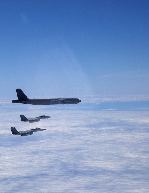 A B-52H Stratofortress deployed from Barksdale Air Force Base, La., flies alongside two Japan Air Self-Defense Force F-15s over the Sea of Japan while conducting a Bomber Task Force mission June 16, 2020. Bomber Task Force missions help maintain global stability and security while enabling units to become familiar with operations in different regions. (Courtesy photo)