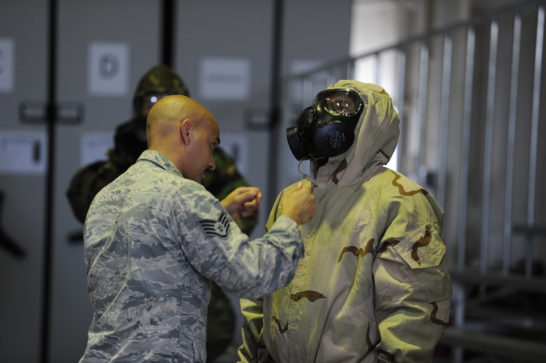 Staff Sgt. Omar M. Mincey, 940th Air Refueling Wing emergency manager, inspects the chemical, biological, radiological and nuclear uniform of Staff Sgt. Gilbert Brooks, 940th Logistics Readiness Squadron decentralized material supply technician, June 13, 2020, at Beale Air Force Base, California.