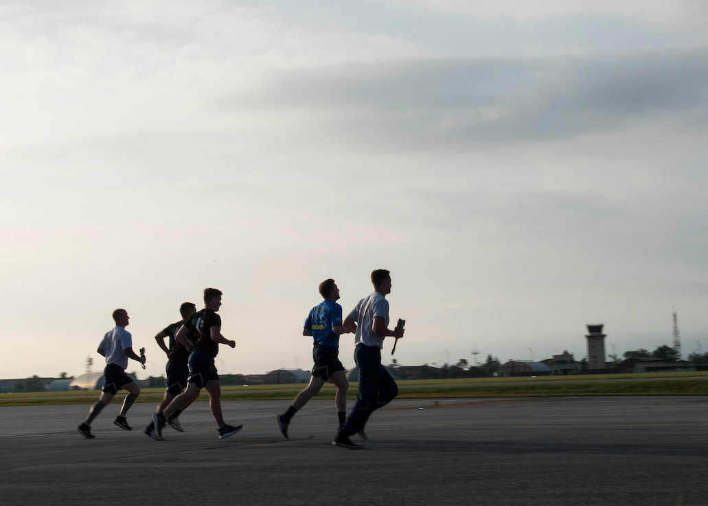 Members of the 724th Air Mobility Squadron participate in a memorial run at Aviano Air Base, Italy, June 18, 2020.