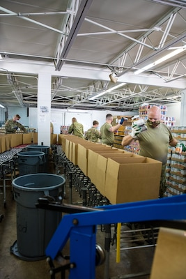 Soldiers from the 1433rd and 1434th Engineer Companies, Michigan Army National Guard, package over 1,000 meal boxes a day at Gleaners Community Food Bank in Pontiac in response to COVID-19, May 20, 2020. Guard members are serving at six food distribution sites across the state.