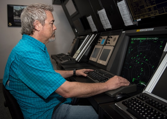 David Bowles monitors aircraft in radar approach control facility