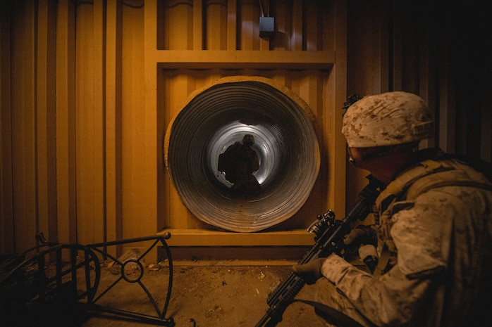U.S. Marines with 3rd Battalion, 4th Marines, 7th Marine Regiment, 1st Marine Division move through a tunnel during Integrated Training Exercise (ITX) 5-20 at Marine Corps Air Ground Combat Center (MCAGCC), Twentynine Palms, Calif., June 2, 2020. ITX is the most comprehensive training conducted at MCAGCC and focuses on the tactical application of combined-arms maneuver and offensive and defensive operations during combat. (U.S. Marine Corps photo by Cpl. Corey Mathews)