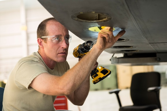 Staff Sgt. Doug Miller, an aircraft maintainer for the 167th Maintenance Group, clears corroded drainage channels inside a C-17 Globemaster III aircraft's cargo ramp canted bulkhead which had corroded over time due to sealed drainage holes, May27, 2020,at the 167th Airlift Wing, Martinsburg, W.Va.