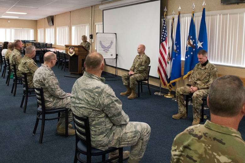 During an assumption of command ceremony for 167th Mission Support Group attendees were limited and maintained social distance at the 167th Airlift Wing, Martinsburg, W. Va., June 11, 2020. Airmen returned to base for the first unit training assembly in two months, after regularly-scheduled training events were cancelled in April and May because of COVID-19 precautions. Airmen are using, homemade masks, social distancing, staggered schedules, and plexiglass barriers to defend themselves from the virus.