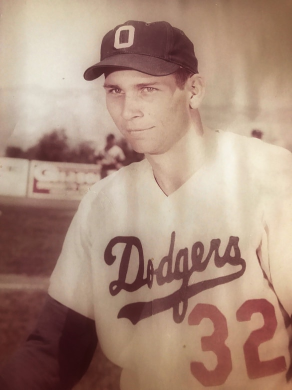 Baseball player in a Ogden (Utah) Dodgers uniform poses for a photo.