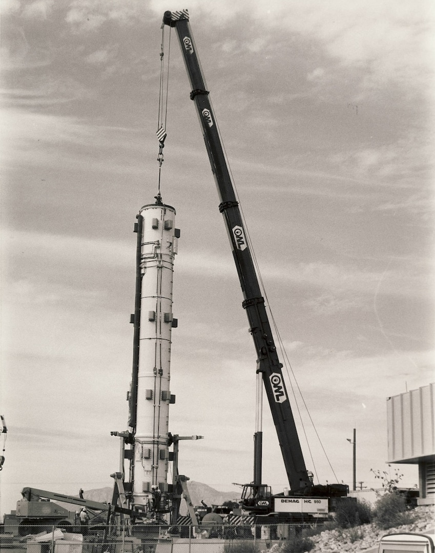 The Hill Engineering and Test Facility received several upgrades and additions during the 1960s, 70s, and 80s. During 1989, the Peacekeeper ICBM portion of the facility became operational. This photograph depicts the installation of an inert Peacekeeper ICBM as it was lowered into its silo at the facility.