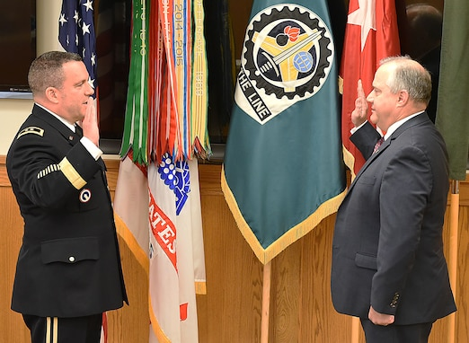 Maj. Gen. Steven Shapiro, commanding general, U.S. Army Sustainment Command, reads the oath of office, swearing Dan Reilly in to the Senior Executive Service at Rock Island Arsenal, IIlinois, June 4.