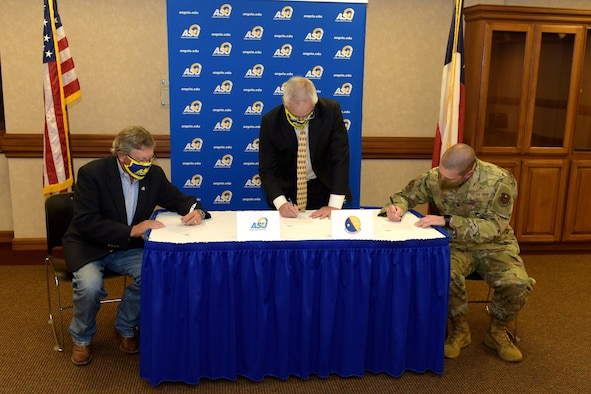 The Provost and Vice President of Academic Affairs of Angelo State University Donald Topliff; the Dean of Science and Engineering of ASU Paul Swets, and U.S. Air Force Major David Coté, 17th Communication Squadron commander, sign an agreement providing Airmen a new opportunity to earn a bachelor's degree, at ASU's Houston Harte University Center, in San Angelo, Texas, June 15, 2020. With this new agreement, individuals will be able to receive credit for all of their academic coursework, as well as credit for up to 60 credit hours of technical course work. (U.S. Air Force photo by Senior Airman Zachary Chapman)
