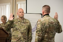 Col. Bill Annie takes the oath of office upon his promotion to colonel during a ceremony held in the 167th Airlift Wing's dining facility, June 13, 2020. Annie also assumed command of the 167th Missin Support group during the ceremony.