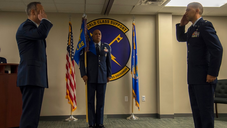 U.S. Air Force Col. Edward Phillips, the 6th Mission Support Group commander, salutes Lt. Col. Christopher Martagon, the 6th Logistics Readiness Squadron commander, during a change of command ceremony, June 12, 2020, at MacDill Air Force Base, Fla.