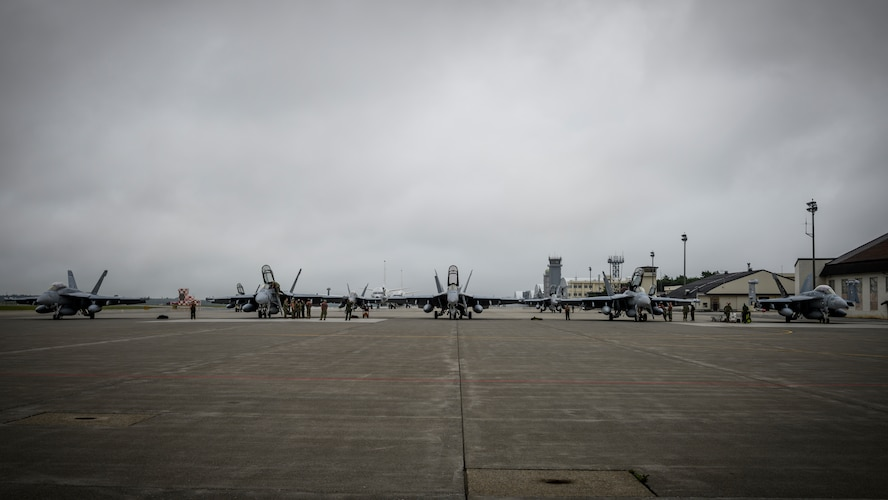 Five U.S. Navy Boeing EA-18Gs sit on the flightline during a PAC Weasel exercise at Misawa Air Base, Japan, June 19, 2020. The objective of this exercise was to integrate U.S. Navy and U.S. Air Force assets to simulate the suppression of enemy air defenses as one cohesive unit, which consisted of 21 aircraft, 16 F-16 Fighting Falcons, four Boeing EA-18G Growlers and a Boeing P-8 Poseidon. (U.S. Air Force photo by Airman 1st Class China M. Shock)