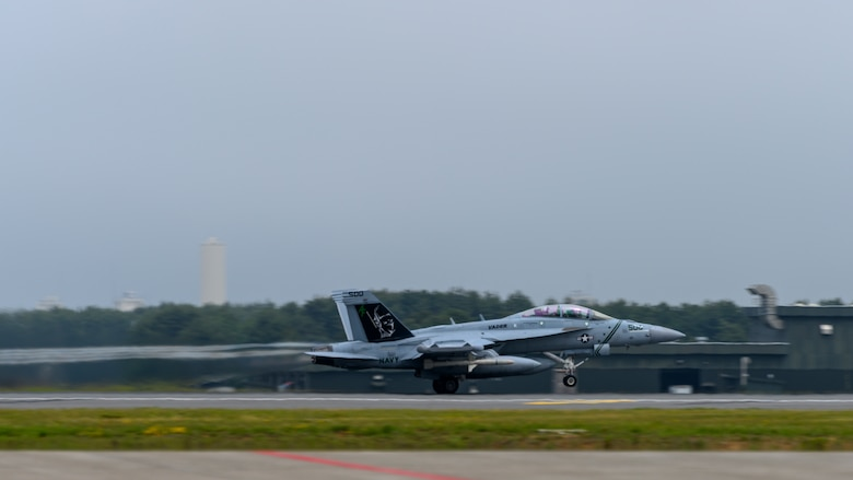 A U.S. Navy Boeing EA-18G takes off down the runway during a PAC Weasel exercise at Misawa Air Base, Japan, June 19, 2020. During PAC Weasel, pilots practiced flying SEAD missions, escort missions, strike missions as well as anti-surface warfare. (U.S. Air Force photo by Airman 1st Class China M. Shock)