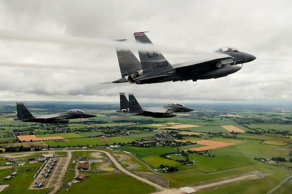 """F-15E Strike Eagles assigned to the 494th Fighter Squadron perform a missing-man formation in memory of 1st Lieutenant Kenneth Allen as he is transported home at Royal Air Force Mildenhall, England June 18, 2020. """"We are deeply saddened by the loss of Lt. Allen, and mourn with his family and his fellow Reapers in the 493rd Fighter Squadron,"""" said Col Will Marshall, 48th Fighter Wing commander. (U.S. Air Force photo/Master Sgt. Matthew Plew)"""