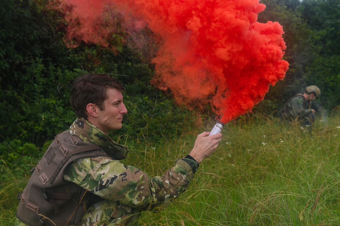 U.S. Air Force Capt. James Gregory, 510th Fighter Squadron pilot, pops a flare to signal an aircraft during an exercise at Rivolto Air Base, Italy, June 10, 2020. The pilots were undergoing a simulated Survival, Evasion, Resistance, Escape (SERE) training in which they had to survive and make contact with the proper sources after landing in enemy territory. (U.S. Air Force photo by Airman 1st Class Thomas S. Keisler IV)