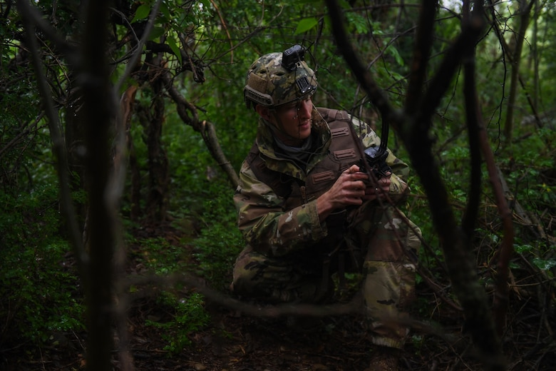 U.S. Air Force Capt. James Gregory, 510th Fighter Squadron pilot, uses his radio during a Survival, Evasion, Resistance, Escape (SERE) training event at Rivolto Air Base, Italy, June 10, 2020. SERE instructors conduct operations around the world preparing aircrew personnel to return from any type of survival situation. (U.S. Air Force photo by Airman 1st Class Thomas S. Keisler IV)