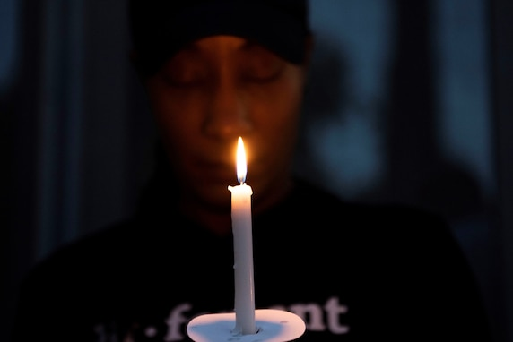 U.S. Air Force Chief Master Sgt. Tomeika Frazier, 39th Communications Squadron superintendent, prays during a candlelight vigil June 17, 2020, at Incirlik Air Base, Turkey. The 39th Air Base Wing chapel hosted the event as a show of solidarity against racial injustice. (U.S. Air Force photo by Staff Sgt. Joshua Magbanua)