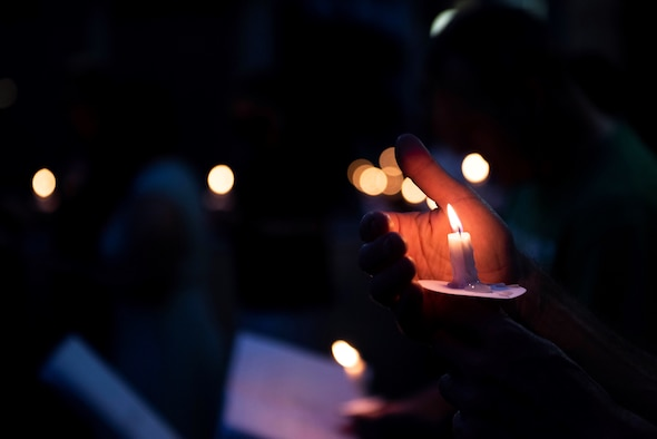 Close up photo of an Airman holding a candle