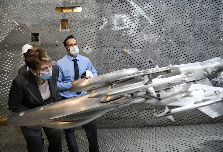 Secretary of the Air Force Barbara Barrett looks at a model of an F-18 Super Hornet in the Arnold Engineering Development Complex 16-foot Transonic Wind Tunnel during her visit, June 18, 2020, to Arnold Air Force Base, Tenn. Also pictured is Dr. Rich Roberts, flight commander for store separation. (U.S. Air Force photos by Jill Pickett)