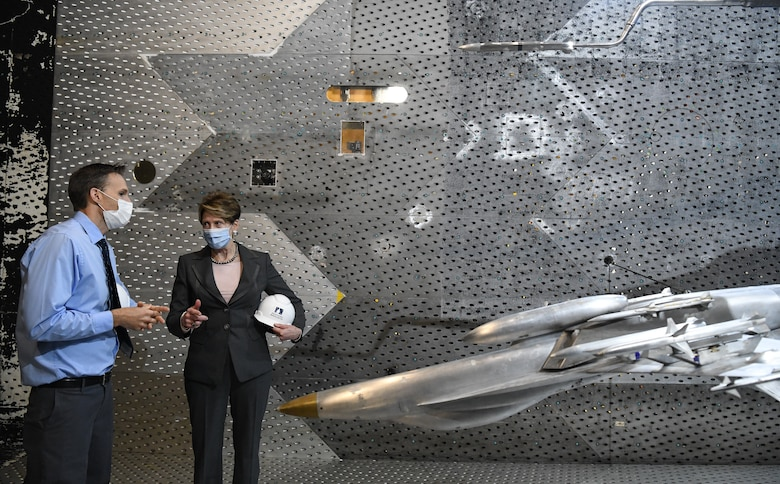 Dr. Rich Roberts, flight commander for store separation, speaks with Secretary of the Air Force Barbara Barrett about a store separation test of a AARGM-ER from an F-18 Super Hornet using models in the Arnold Engineering Development Complex 16-foot Transonic Wind Tunnel at Arnold Air Force Base, Tenn., June 18, 2020. (U.S. Air Force photo by Jill Pickett)