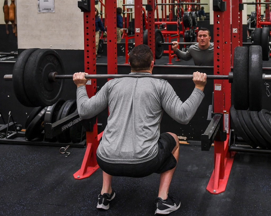 A person performing the squat exercise.