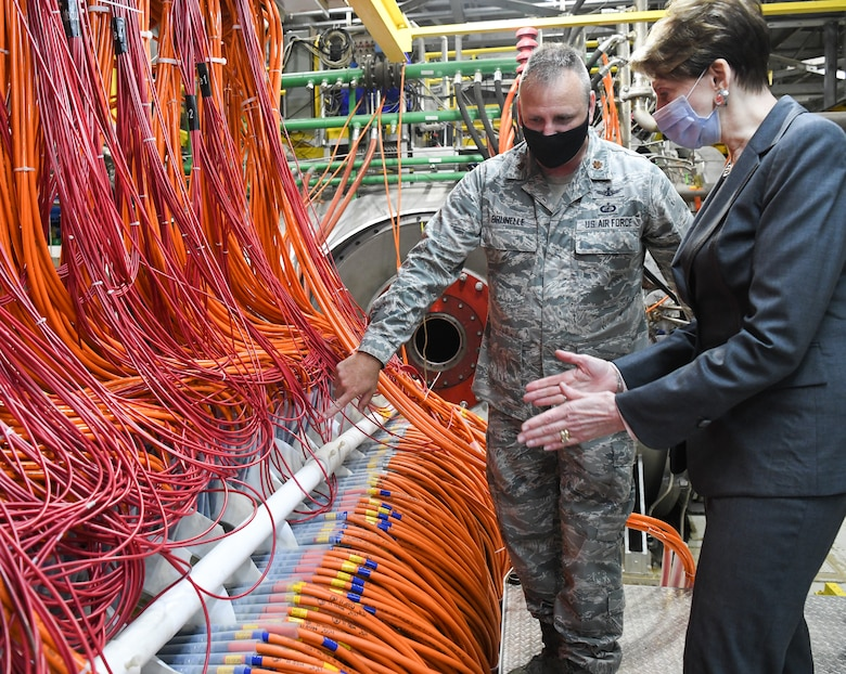 Maj. Christopher Brunelle, director of operations for the Arnold Engineering Development Complex Space and Missile Branch, explains the construction of an arc heater to Secretary of the Air Force Barbara Barrett during her visit, June 18, 2020, to Arnold Air Force Base, Tenn. Arc heaters provide high-enthalpy test environments to test materials and other means of thermal protection. (U.S. Air Force photo by Jill Pickett)
