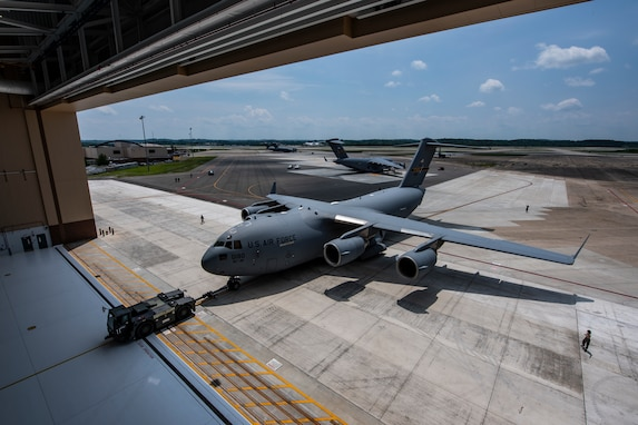 Airmen tow a C-17 Globemaster III into the new two-bay hangar