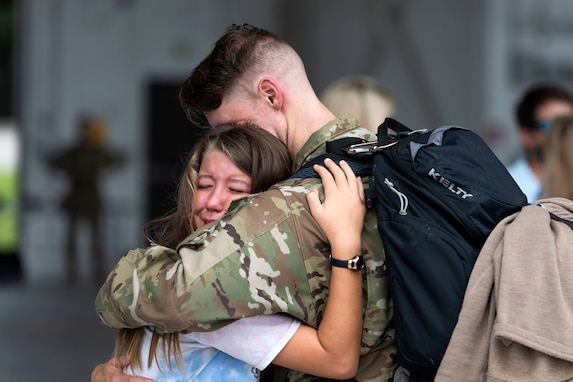Rescue Squadron loadmaster hugs his daughter upon returning from a deployment