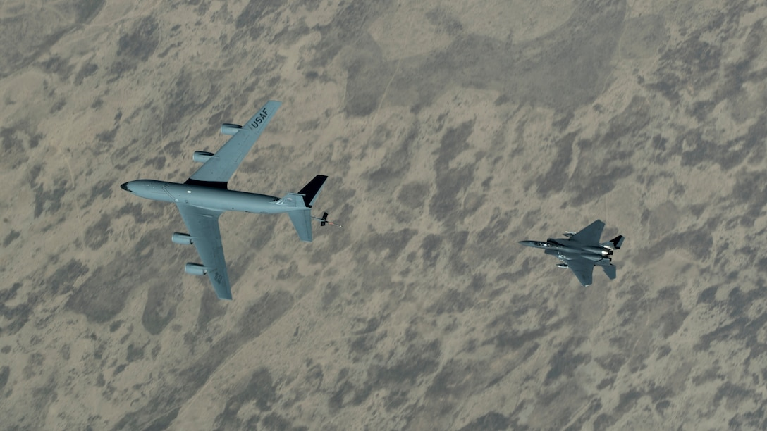 An F-15E Strike Eagle assigned to the 492nd Expeditionary Fighter Squadron approaches a KC-135 Stratotanker with the 28th Expeditionary Air Refueling Squadron over the U.S. Central Command area of responsibility, June 12, 2020. The 28th EARS, deployed with U.S. Air Forces Central Command, is responsible for delivering fuel to U.S. and coalition forces providing air power, deterrence and stability to the region. (U.S. Air Force photo by Senior Airman Brandon Cribelar)