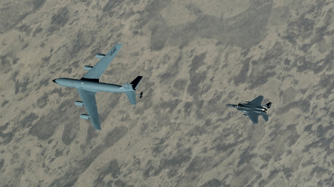 An F-15E Strike Eagle approaches a KC-135 Stratotanker