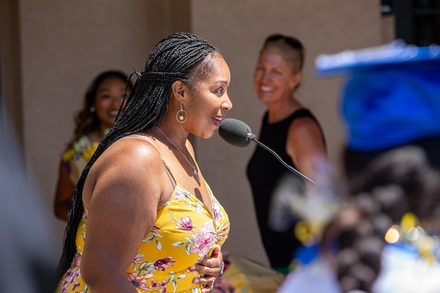Elizabeth Burns, the organizer for the 2020 graduation event, gives congratulations to the students and thanks the fellow spouses that made the event possible at the Milcon Clubhouse on Marine Corps Air Station Miramar, California, June 13, 2020.