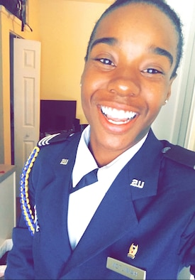 U.S. Air Force 2nd Lt. Destini Hamilton poses in her ROTC uniform before an event.