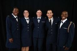 U.S. Air Force 2nd Lt. Amirah Latiff, 2nd Lt. Gabrielle Payne, 2nd Lt. Kennedy DiBerardino, 2nd Lt. Julian Lawson, and 2nd Lt. Destini Hamilton, pose for a photo in their ROTC attire.