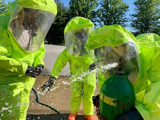 Staff Sgt. Patrick Iliff, Senior Airman Eva Chupp, and Master Sgt. Anthony Chico, 434th Civil Engineering Squadron emergency management apprentices, cap a simulated leak on a chlorine canister. Emergency managers must be prepared at all times to respond to manmade and natural disasters both on base and in deployed locations at any time. (U.S. Air Force photo / Staff Sgt. Clint Hazlett