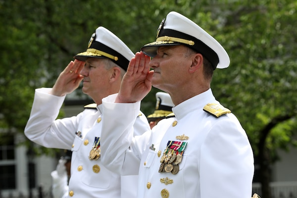 Vice Admiral William J. Galinis (right) and Vice Admiral Thomas J. Moore salute Galinis' flag during the Naval Sea Systems Command (NAVSEA) Change of Command Ceremony in Leutze Park at the Washington Navy Yard.