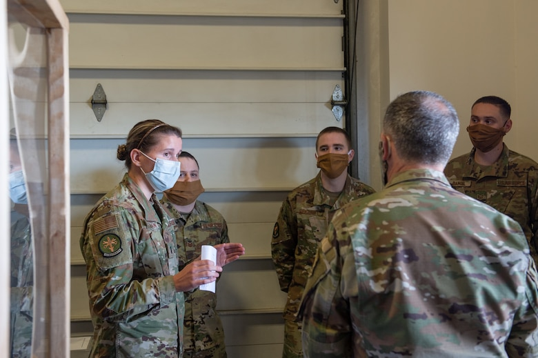First Lt. Kristina O'Sullivan, 62nd Aircraft Maintenance Squadron flight commander, left, shows Gen. David Goldfein, chief of staff of the Air Force, right, how the 62nd AMXS Consolidated Tool Kit shop is preventing the spread of COVID-19 at Joint Base Lewis-McChord, Wash., June 18, 2020. Goldfein believes that if Airmen continue to remain disciplined and diligent following the procedures that have been put in place, the Air Force will continue to operate and survive during the pandemic. (U.S. Air Force photo by Senior Airman Sara Hoerichs)