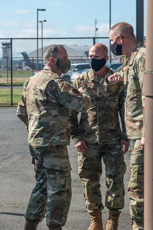 Chief Master Sgt. John Lipsey, 62nd Maintenance Group command chief, right, and Col. Aaron Sasson, 62nd Maintenance Group commander, center, greet Gen. David Goldfein, chief of staff of the Air Force at Joint Base Lewis-McChord, Wash., June 18, 2020. (U.S. Air Force photo by Senior Airman Sara Hoerichs)