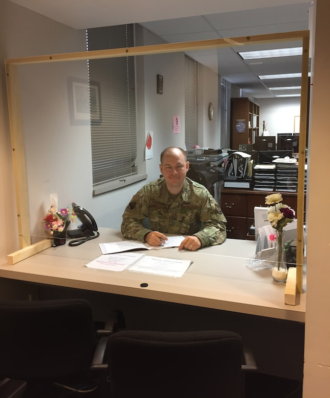Staff Sgt. Derek Wooten, a paralegal in the 88th Air Base Wing Legal Office, Wright-Patterson Air Force Base, shows on June 16 how the Legal clinic has been modified to protect clients due to the COVID-19 pandemic. Due to the declared public health emergency on base, in-person consultations are limited to specific situations at this time at this time. (Skywrighter photo/Amy Rollins)