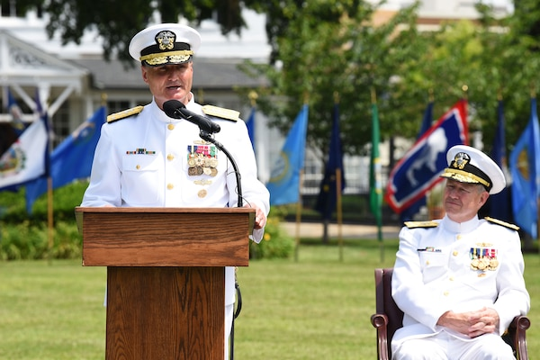Vice Admiral William J. Galinis, left, speaks as Vice Admiral Thomas Moore looks on during a Change of Command ceremony for Naval Sea Systems Command (NAVSEA). Galinis took over for Moore as Commander, NAVSEA during the ceremony held in Leutze Park at Washington Navy Yard.