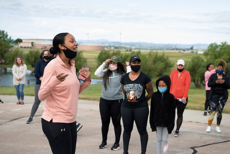 aster Sgt. Jessica Wheeler, the 28th Force Support Squadron section chief of readiness and plans, talks to participants of a memorial walk for Juneteenth at Ellsworth Air Force Base, S.D., June 19, 2020.