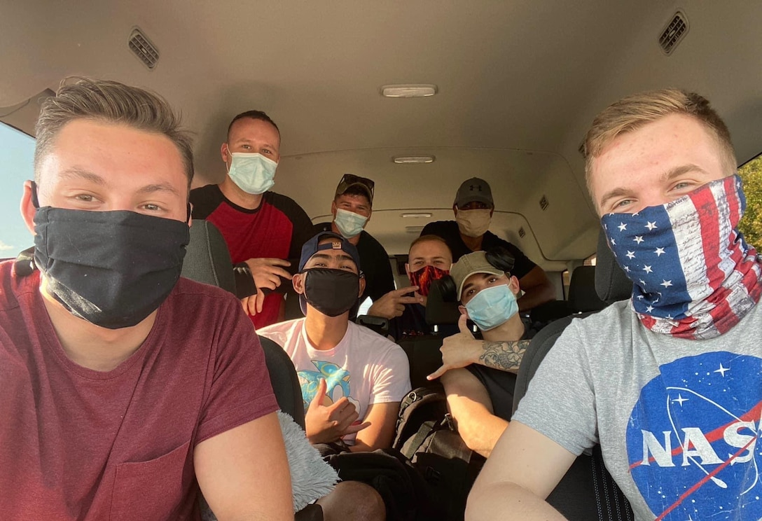 Members of the 47th Flying Training Wing's Honor Guard team, from Laughlin Air Force Base, Texas, pose for a picture in their vehicle during their trip to assist Dyess AFB with and active duty funeral for U.S. Congressman, retired Col. Samuel Robert Johnson, former P.O.W. and prior Thunderbird pilot. The funeral took place June 8, 2020 in Dallas. (Courtesy photo)