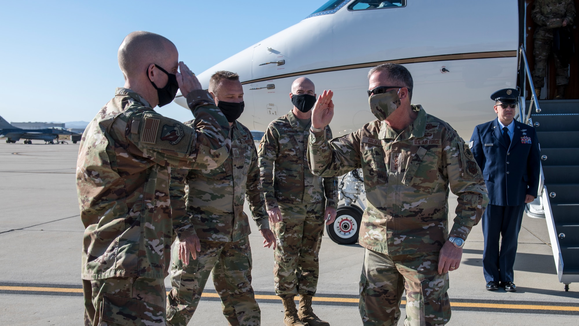 Brig. Gen. Matthew Higer, 412th Test Wing commander, salutes Air Force Chief of Staff Gen. David Goldfein at Edwards Air Force Base, California, June 17. (Air Force photo by Giancarlo Casem)