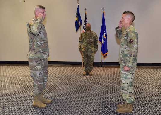 U.S. Air Force Maj. William Bennett, 17th Communications Squadron commander, right, assumes command from presiding official Col. Tony England, 17th Mission Support Group commander, during the 17th CS Change of Command ceremony on Goodfellow Air Force Base, Texas, June 18, 2020. Bennett took over the squadron from Maj. David Cote, former 17th CS commander, who led the unit for the past two years. (U.S. Air Force photo by Staff Sgt. Chad Warren)