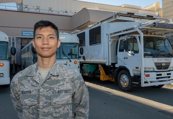 An Airman stands in front of emergency vehicles at David Grant USAF Medical Center.