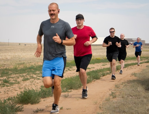 Airmen run during a watermelon run June 17, 2020, at Schriever Air Force Base, Colorado. The activity is organized by Joggernauts running club, which meets at Schriever Wednesdays at 3 p.m. at the base fitness center and Saturdays at 8 a.m. in various locations around Colorado Springs. (U.S. Air Force photo by Airman 1st Class Jonathan Whitely)